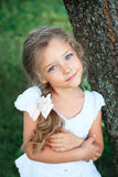 Cute little girl on nature in summer day Royalty Free Stock Photo
