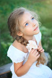Cute little girl on nature in summer day looking up royalty free stock photography