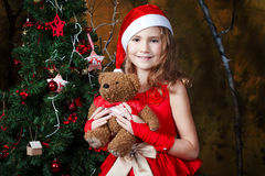 Cute little girl near a Christmas tree Stock Images