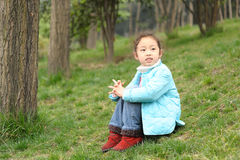 Cute Little Girl On Grass Stock Photography