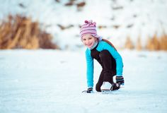 Cute Little Girl On The Ice In Stock Photos