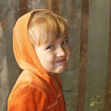 Cute little girl in orange hood Royalty Free Stock Photos