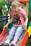 Cute little girl on outdoor playground. Stock Image
