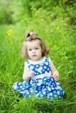 Cute little girl outdoors Stock Photos