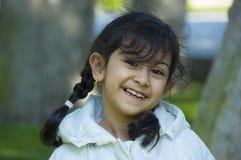 Cute little girl outdoors Stock Photo