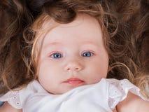 Cute little girl over mommy hair Stock Photo