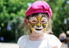 Cute little girl with painted face Royalty Free Stock Photography