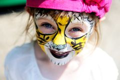 Cute little girl with painted face Stock Photography
