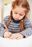 Cute little girl painting Stock Images