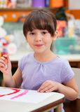 Cute Little Girl Painting In Art Class. Portrait of cute little girl painting in art class royalty free stock photography