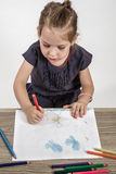 Cute Little Girl Painting on Royalty Free Stock Image