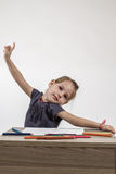 Cute Little Girl Painting on Stock Photography