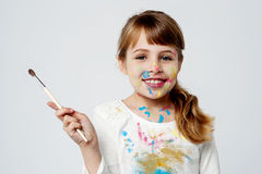 Cute little girl with a painting brush Royalty Free Stock Photography