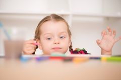 Cute little girl painting Stock Image