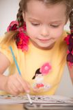 Cute little girl painting Royalty Free Stock Photo