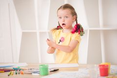 Cute little girl painting Stock Photos