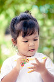 Cute little girl is painting on her hand Royalty Free Stock Photos