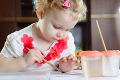 Cute little girl painting at home Royalty Free Stock Photo