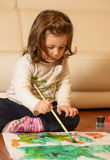 Cute little girl painting at home Stock Image