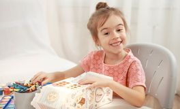 Cute little girl drawing with pencils at home royalty free stock photos