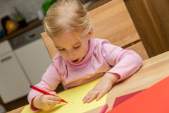 Cute little girl is painting a picture Stock Photography