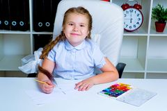 Cute little girl painting with watercolor stock images