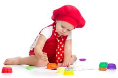 Cute little girl painting on white Cute little girl painting isolated on white stock images