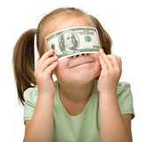Cute little girl with paper money - dollars Stock Image