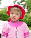 Cute little girl in a park close up Stock Photos