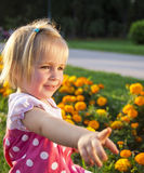 Cute little girl in a park Stock Photo