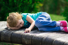 Cute little girl in the park in summer day Royalty Free Stock Photos