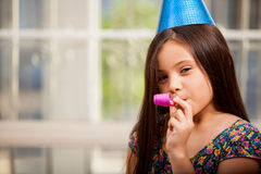 Cute little girl in a party hat Royalty Free Stock Photos