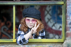 Cute little girl with peace sign Royalty Free Stock Image