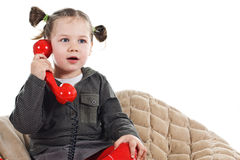Cute little girl phoning Stock Photography