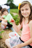 Girl picking strawberries Stock Photos