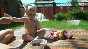 Cute little girl on picnic stock footage