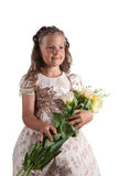 Cute little girl with pigtail hairstyle. Holding flowers, isolated on white background Royalty Free Stock Images