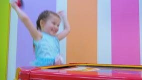 Little girl playing air hockey