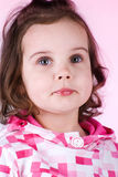 Cute little girl on pink Stock Photography