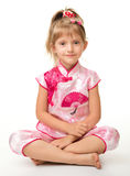 Cute little girl in pink ba ba shirt (Vietnamese) Royalty Free Stock Photography