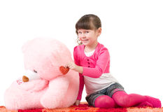 Cute little girl with pink bear Royalty Free Stock Photos