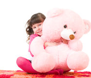 Cute little girl with pink bear Royalty Free Stock Image