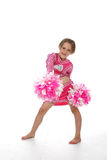 Cute little girl in pink cheering outfit. And pom poms Stock Photography