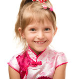 Cute little girl in pink dress Stock Image