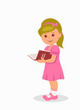 Cute little girl in a pink dress reading a book.  character child standing with a book Stock Image