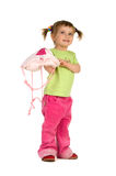 Cute little girl with pink knapsack stock photos