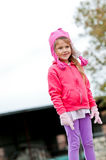 Cute little girl in pink outdoors. Stock Photo