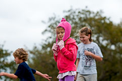 Cute little girl in pink outdoors. Royalty Free Stock Photography