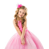 Cute little girl in pink princess dress, isolated on white background Stock Photography