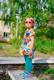 Cute little girl in pink sunglasses Royalty Free Stock Photography